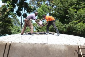 The Water Project:  Cooperation Of The Artisans To Get Cement And Sand Mixture To The Dome