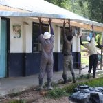 The Water Project: Friends School Shivanga Secondary -  Fixing The Gutters In Place