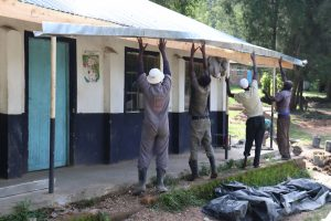 The Water Project:  Fixing The Gutters In Place