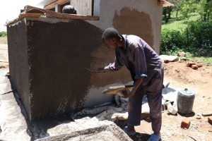 The Water Project:  Roughcasting Latrine Walls