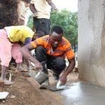 The Water Project: Friends School Shivanga Secondary -  Applying Smooth Cement Coat On Latrine Skirting