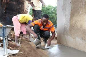 The Water Project:  Applying Smooth Cement Coat On Latrine Skirting
