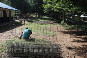 The Water Project:  Securing The Wire Frame Of The Tank