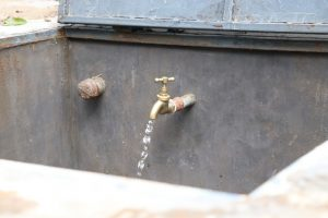 The Water Project:  Water Flowing At The Rain Tank