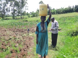 The Water Project:  Agnes Kutoto Carrying Water From Anunda Spring