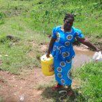 The Water Project: Mahira Community, Anunda Spring -  Carrying Water