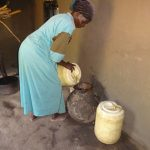 The Water Project: Mahira Community, Anunda Spring -  Pouring Water Into Storage Container