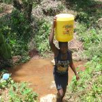 The Water Project: Shihome Community, Peter Majoni Spring -  Carrying Water