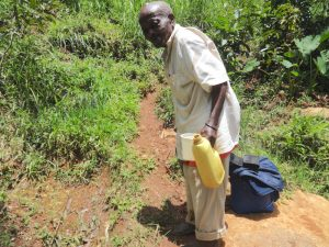The Water Project:  Carrying Water From The Unprotected Spring