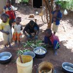 The Water Project: Indulusia Community, Yakobo Spring -  A Family Preparing Lunch