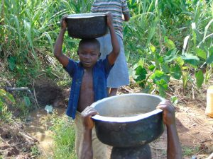 The Water Project:  Carrying Water From The Spring