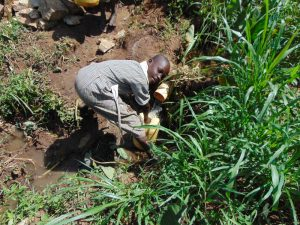 The Water Project:  Collecting Water From The Spring