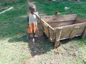 The Water Project:  Child Next To Animal Feeding Trough