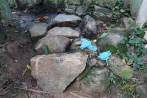 The Water Project:  Bathing Shelter Rock Floor With Washcloths