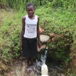 The Water Project: Shitavita Community, Patrick Burudi Spring -  Collecting Water