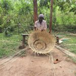 The Water Project: Shitavita Community, Patrick Burudi Spring -  Mr Burudi Weaving A Basket