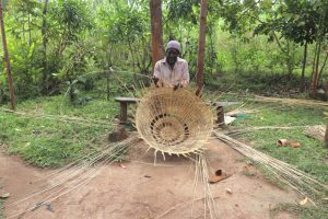 The Water Project:  Mr Burudi Weaving A Basket