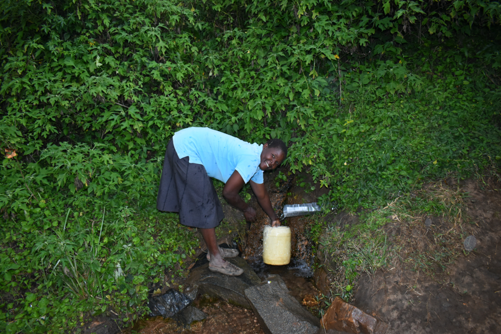 The Water Project : kenya20221-ruth-fetches-water-2
