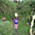 The Water Project: Mukhungula Community, Mulongo Spring -  Carrying Water Home