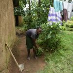 The Water Project: Mukhungula Community, Mulongo Spring -  Cleaning The Compound