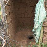 The Water Project: Mukhungula Community, Mulongo Spring -  Latrine Floor