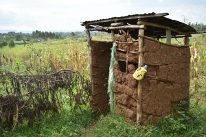 The Water Project:  Latrine With Leaky Tin For Handwashing Tied To Pole