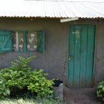 The Water Project: Mukhungula Community, Mulongo Spring -  Rain Tank Next To Door