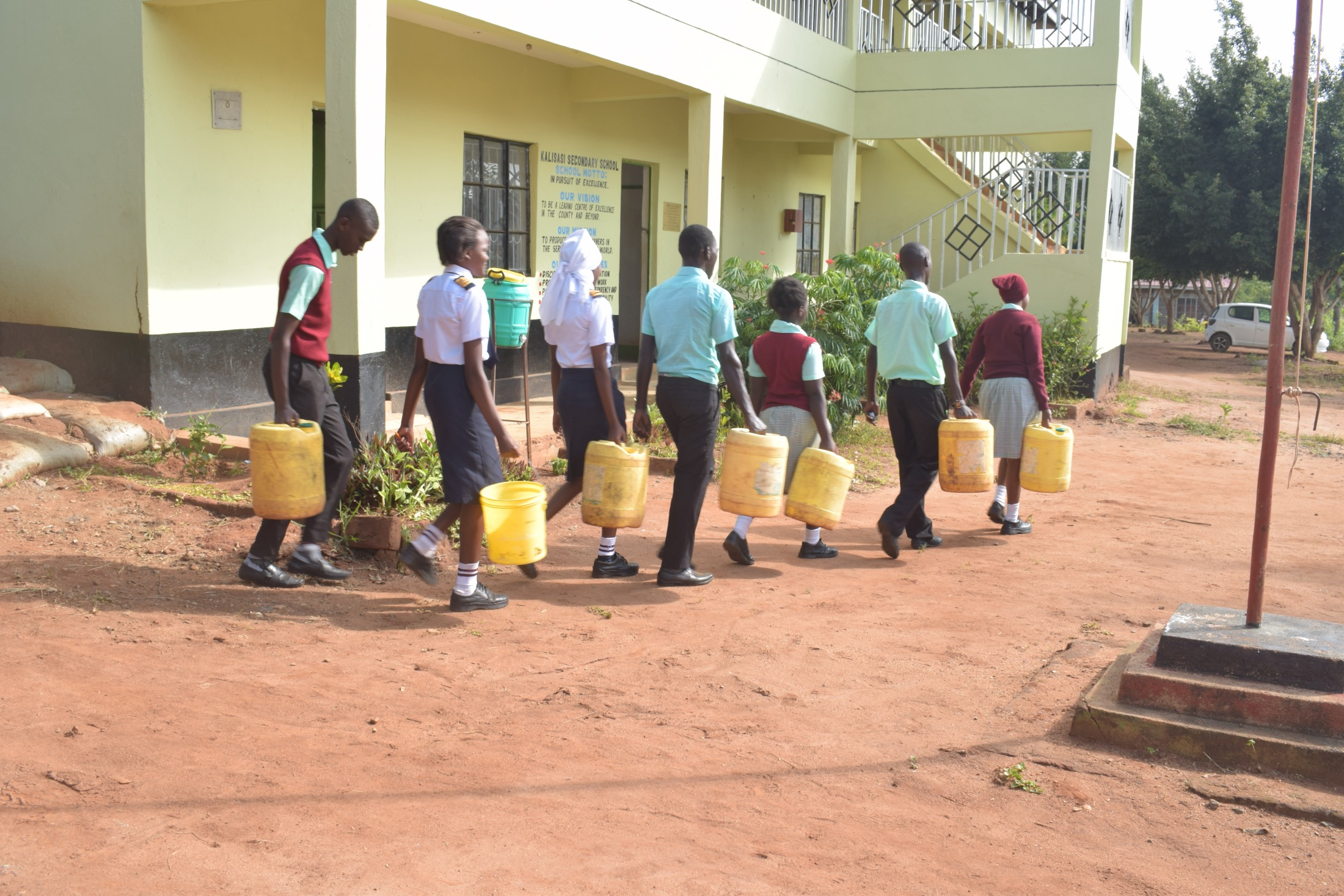 The Water Project : kenya20366-students-carrying-water-1
