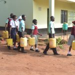 The Water Project: Kalisasi Secondary School -  Students Carrying Water