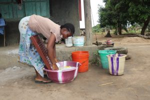 The Water Project:  Woman Laundrying