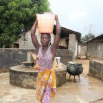 The Water Project: Lungi, Suctarr, #3 Lovell Lane -  Young Girl Carrying Water