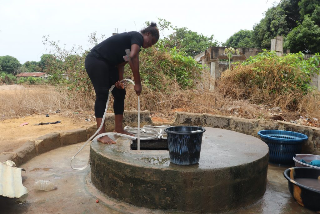 The Water Project : sierraleone20412-young-girl-collecting-water-2