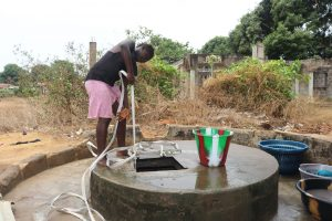 The Water Project:  Young Girl Collecting Water