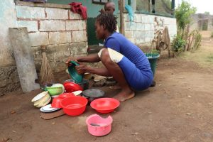 The Water Project:  Woman Clean Dishes