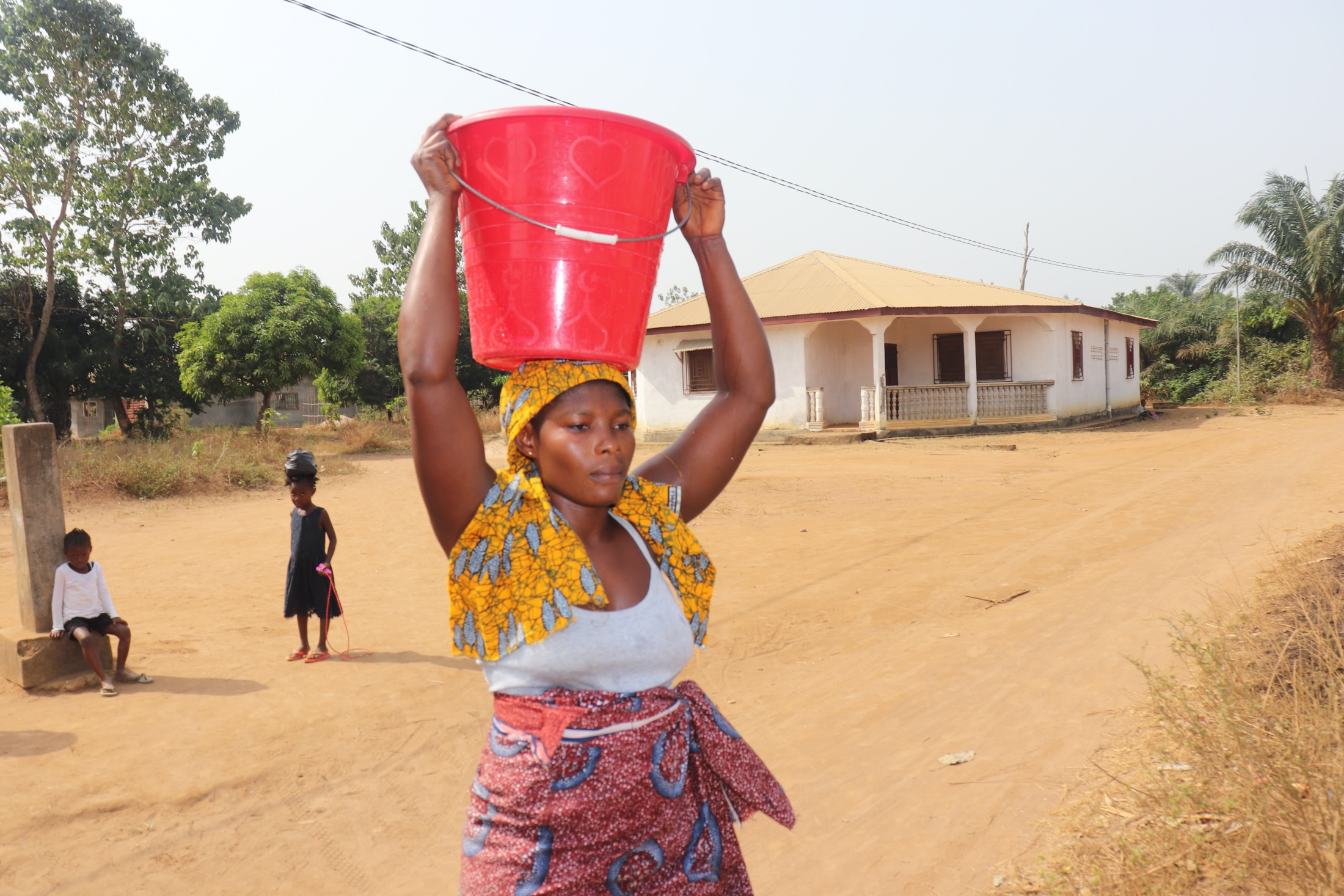 The Water Project : sierraleone20426-woman-carrying-water-1