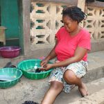 The Water Project: Lungi, New London, Saint Dominic's Catholic Church -  Woman Cleaning Up Fishes