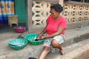 The Water Project:  Woman Cleaning Up Fishes