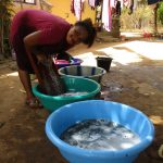 The Water Project: Lungi, New London, Saint Dominic's Catholic Church -  Woman Laundering