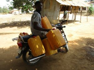 The Water Project:  Young Man With Containers To Collect Water