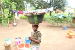 The Water Project:  Kid Selling Fish
