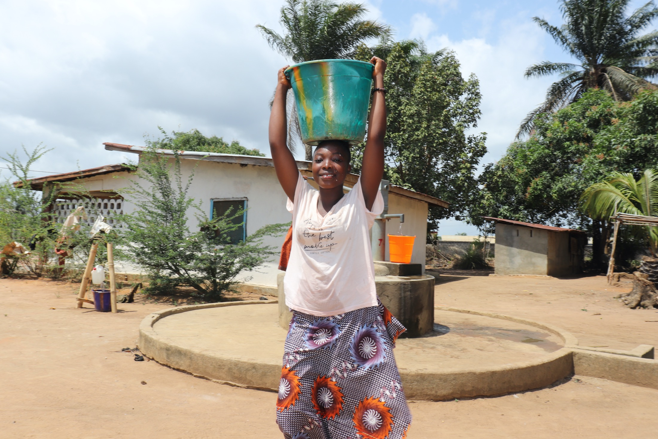The Water Project : sierraleone20429-carrying-water-3