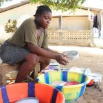 The Water Project: Lungi, Suctarr, #47 Kamara Street -  Young Girl Cleaning Up Dishes