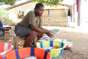 The Water Project:  Young Girl Cleaning Up Dishes