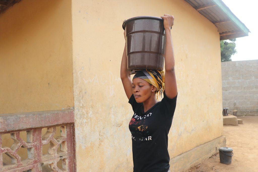 The Water Project : sierraleone20430-community-member-carrying-water-3-2