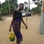 The Water Project: Lungi, Rotifunk, 22 Kasongha Road -  Community Member Carrying Water