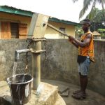 The Water Project: Lungi, Rotifunk, 22 Kasongha Road -  Member Collecting Water