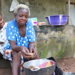 The Water Project: Lungi, Suctarr, #1 Kabbia Lane -  Old Woman Cleaning Fish