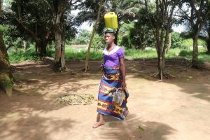 The Water Project:  Young Lady Selling Palm Oil