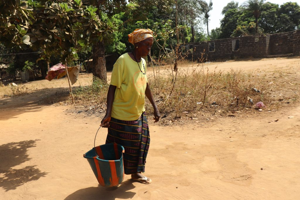 The Water Project : sierraleone20431-old-woman-carrying-water