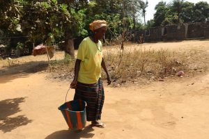 The Water Project:  Old Woman Carrying Water